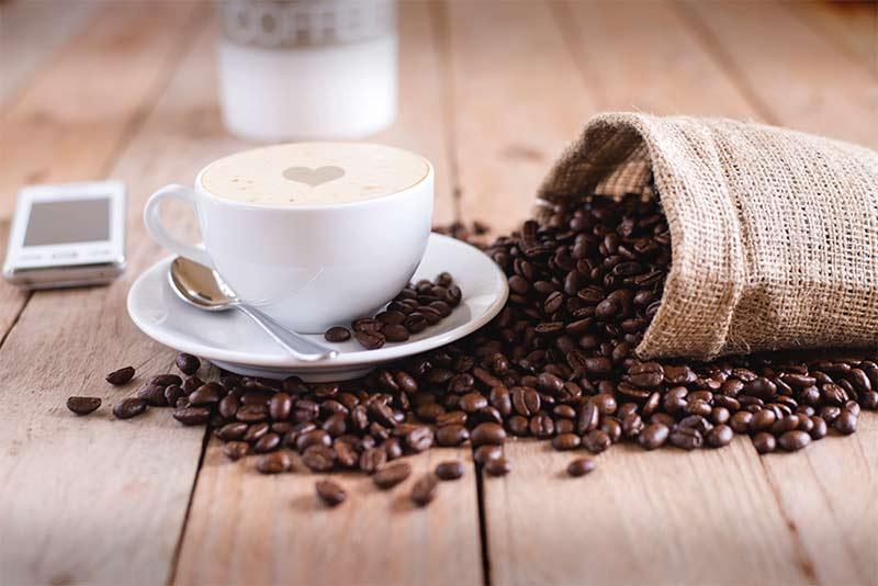 Coffee cup and mobile phone - Tinnitus